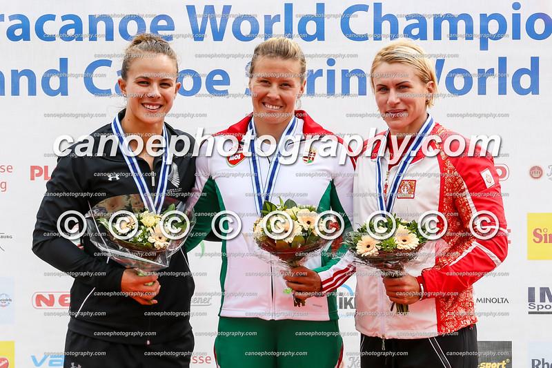 Women's K1 500m event podium at the ICF Canoe Sprint World Cup in Duisburg, Germany (L-R): Lisa Carrington (NZL), Danuta Kozak (HUN), Inna Osipenko-Rodomska (AZE).