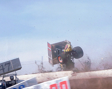 Flipping out of I-70 - After the car landed on a 4 wheels, it was untangled from the chain link fencing and then pushed off and restarted the race!!