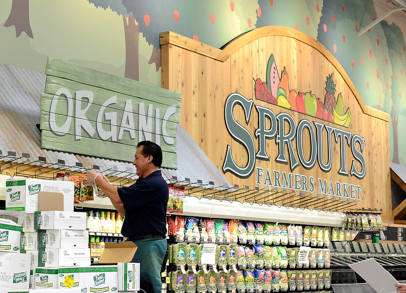 Spouts Farmers Market employee Jose Vasquez stocks croutons on a rack in the rpoduce section at the new Loveland store on Monday, June 27, 2016. They open their doors on Wednesday. (Photo by Jenny Sparks/Loveland Reporter-Herald)