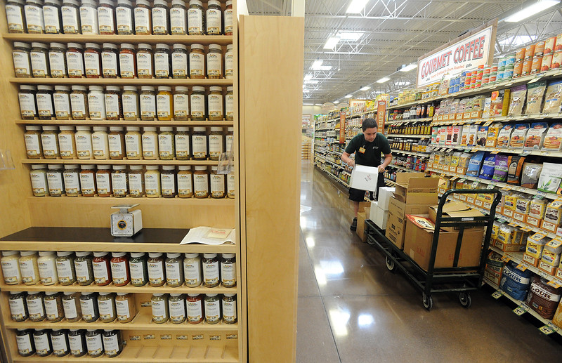 Spouts Farmers Market grocery clerk Mitch Kwan works to stock shelves at the new Loveland store on Monday, June 27, 2016, in preparation of their opening day on Wednesday. (Photo by Jenny Sparks/Loveland Reporter-Herald)