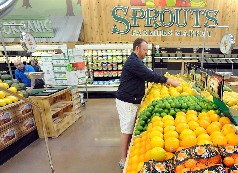 Spouts Farmers Market produce manager Joe Mooney stocks oranges and lemons at the new Loveland store on Monday, June 27, 2016, in preparation of their opening day on Wednesday. (Photo by Jenny Sparks/Loveland Reporter-Herald)