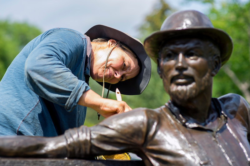 Jo DeDecker waxes a bronze sculpture in the Benson Sculpture Garden in Loveland on July 28, 2016. DeDecker works with her brother cleaning sculptures across the Midwest during the warm summer months. <br /> <br /> Photo by Michael Ortiz/Loveland Reporter-Herald
