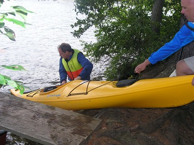 Our campsite has access to a dock for tying off the boats, but due to rain/showers in the forecast we pulled our boats on land and flipped them over to keep water out of them when we were not paddling.