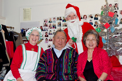 Herb and Bea Chow with Barbara & Frank Erbacher at 49ers Christmas party 2010