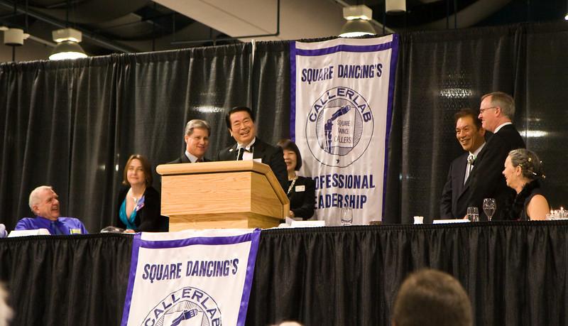 Masaru Wada accepting his award at Callerlab