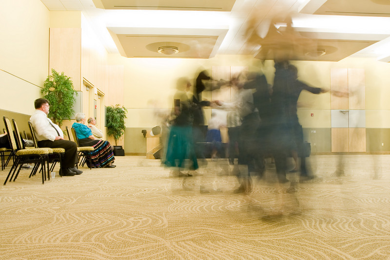 Contra dancers blurred by long exposure at Callerlab