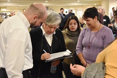 Sr. Norma shares information after her presentation