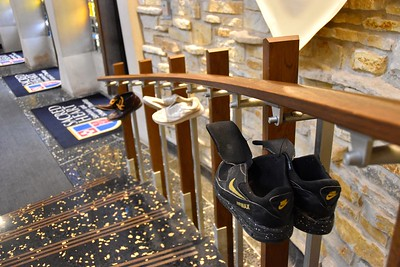 The shoes of migrants were hung throughout the lobby so that people could reflect on the journeys that were made in them.