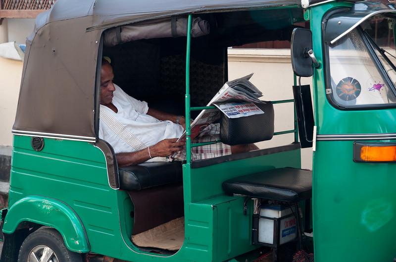 Tuk-tuk driver waits for customers, Galle, Sri Lanka