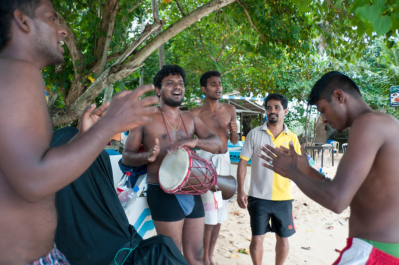 Singing to the beat of a drum on the beach, Unawatuna, Sri Lanka
