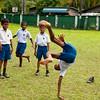 A boy shows his tumbling skills during recess at the Sulaimanya Muslim School.