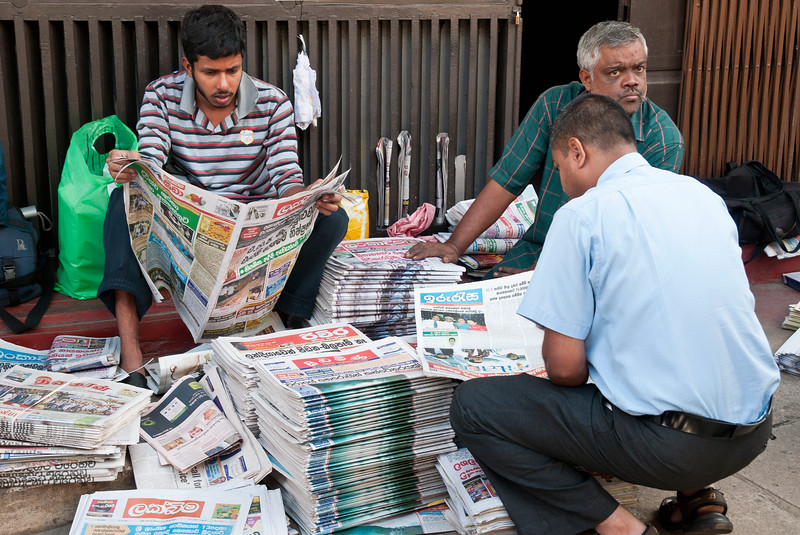 Men read newspapers, Kandy, Sri Lanka
