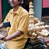 Man transports brassware made in his home shop, Handessa, Kandy, Sri Lanka