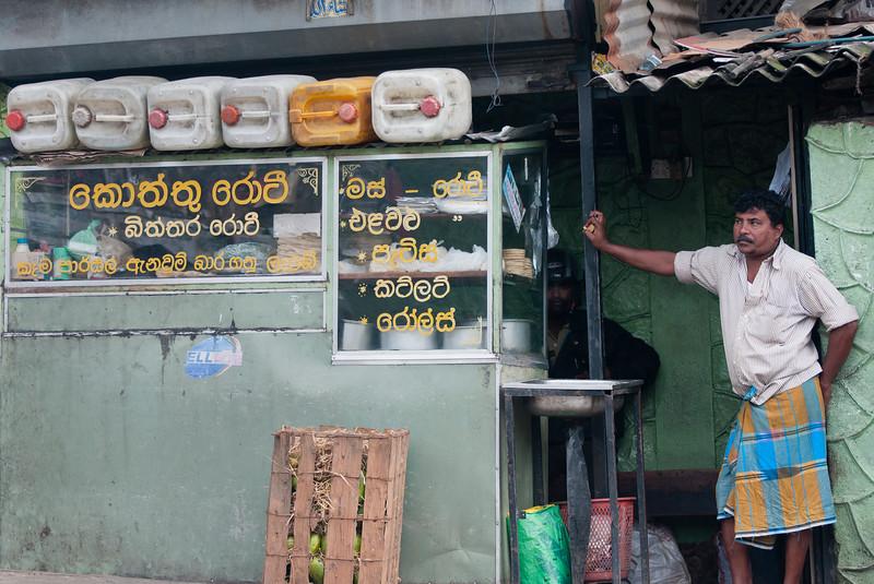 Man at food stall, Bandarawela, Sri Lanka