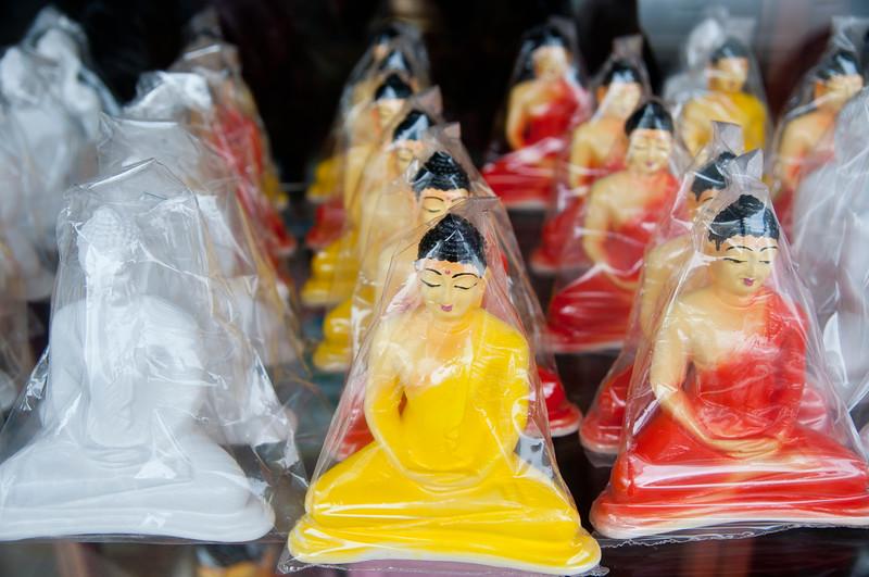Buddhas under plastic, Kandy, Sri Lanka