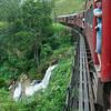 Train passes waterfall between Ella and Haputale, Sri Lanka