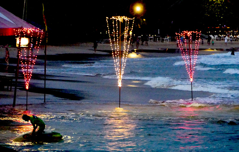 Mirissa  beach with lights of the many cafes lining the beachfront.