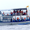 Whale watching boat with tourists.