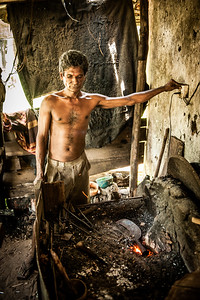 A Sri Lankan Blacksmith working in his forgery, Induruwa, Sri Lanka