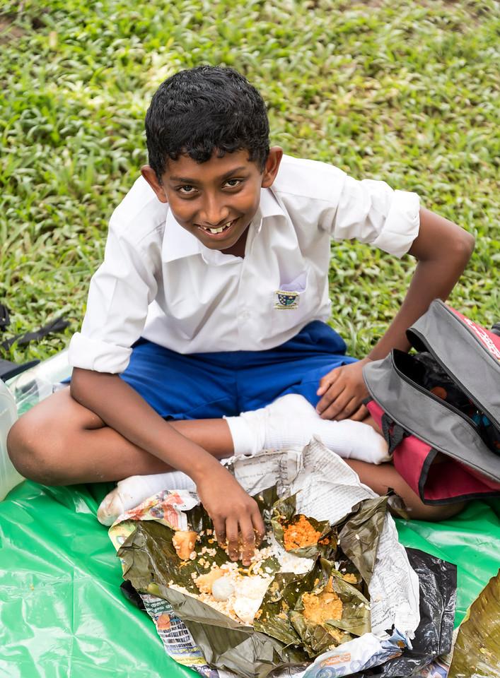 School-boy Eating Lunch