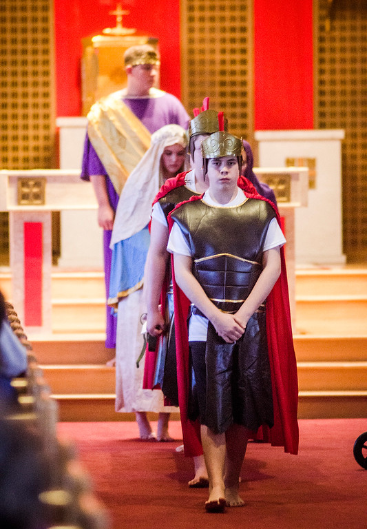 . Students from Saint Anna Catholic School in Leominster perform Living Stations of the Cross at St. Anna Parish on Friday, April 14, 2017.  Pictured front is Zachary Robillard. SENTINEL & ENTERPRISE / Ashley Green