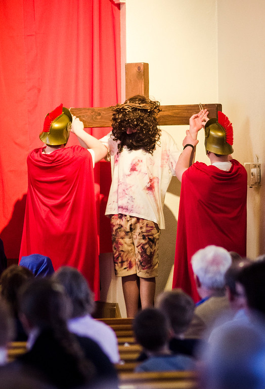 . Students from Saint Anna Catholic School in Leominster perform Living Stations of the Cross at St. Anna Parish on Friday, April 14, 2017. From left, Zachary O\'Toole, Andrew Gardiner and Alex Boulet. SENTINEL & ENTERPRISE / Ashley Green