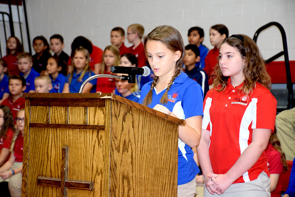 Addison Bunton gives a presentation during the St. Anthony Grade School Veterans Day program held Friday morning in Goff gym. Waiting to speak behind Bunton is Madeiline Lidy. Charles Mills photo