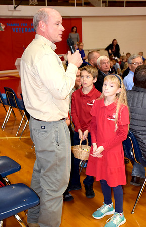 U.S. Army National Guard Veteran Tim Daiber was recognized for his service by students during the St. Anthony High School Veterans Day program held Friday morning. Pictured from left to right, Tim Daiber, Nick Roewe and Ivy Daiber. Charles Mills photo