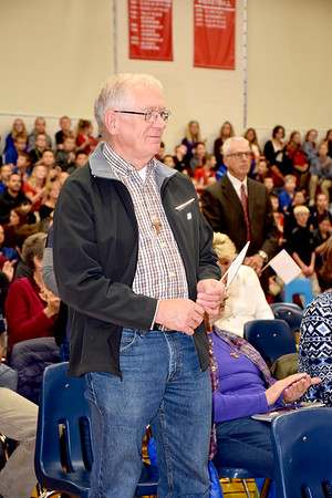 Illinois National Guard veteran Gene Drees serving from 1966-1972 tells the audience about his military experience during the St. Anthony Grade School Veterans Day program. Charles Mills photo