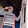 "Parent Volunteer Brian Grubb installs a hinge on a window covering to be used as a prop during the SAHS and SAMBA production of ""Disney's Beauty and the Beast"" next weekend. Charles Mills photo"