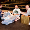 "Co-director Cathy Zaccari, left, Phil Zaccari, middle and Brian Grubb, right, discuss a backdrop to be used for the SAHS and SAMBA production of ""Disney's Beauty and the Beast"" to be presented in the SAHS multipurpose room on Nov. 10, 11 and 12. Charles Mills photo"