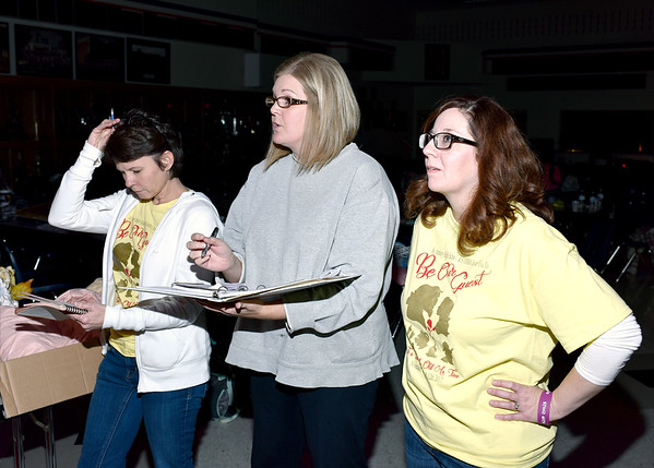 """Co-directors Denise Deters, Nikki Quandt and Cathy Zaccari go over the script with cast and crew members during a recent rehearsal of """"Disney's Beauty and the Beast"""" in the St. Anthony High School multipurpose room. Charles Mills photo"""