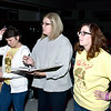 "Co-directors Denise Deters, Nikki Quandt and Cathy Zaccari go over the script with cast and crew members during a recent rehearsal of ""Disney's Beauty and the Beast"" in the St. Anthony High School multipurpose room. Charles Mills photo"