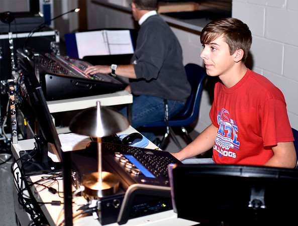 "St. Anthony High School Freshman Kalen Reardon watches stage movement as he sits behind a lighting and audio control panel during a recent rehearsal of ""Disney's Beauty and the Beast"" stage production to be held in the SAHS multipurpose room next weekend. Charles Mills photo"