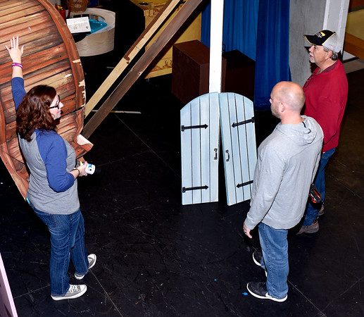 """Co-director Cathy Zaccari, left, talks to parent volunteers Brian Grubb and Tim Griffith about props to be used for SAHS and SAMBA's presentation of """"Dinsey's Beauty and the Beast."""" Charles Mills photo"""