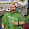 The annual St. Baldrick's event has held at the Pepperell Fire Department on Park Street on Wednesday night in Pepperell. Participants donate money to get people to cut their hair short to raise money for childhood cancer research. Ben Savage gave a wink and a thumps up as he got his hair cut by Kyle Blair from with Patriot Barber Shop in pepperell at the event. SENTINEL & ENTERPRISE/JOHN LOVE