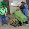 The annual St. Baldrick's event has held at the Pepperell Fire Department on Park Street on Wednesday night in Pepperell. Participants donate money to get people to cut their hair short to raise money for childhood cancer research. Phil Durno, sweeping up the hair, always dresses up to help volunteer at this annual event. He said he has been helping since the beginning 16 years ago. SENTINEL & ENTERPRISE/JOHN LOVE