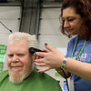 The annual St. Baldrick's event has held at the Pepperell Fire Department on Park Street on Wednesday night in Pepperell. Participants donate money to get people to cut their hair short to raise money for childhood cancer research. Bryan Keith of Gardner gets his hair cut by Ziegler Christina with Serenity Spa and Salon of Tyngsboro at the event. SENTINEL & ENTERPRISE/JOHN LOVE