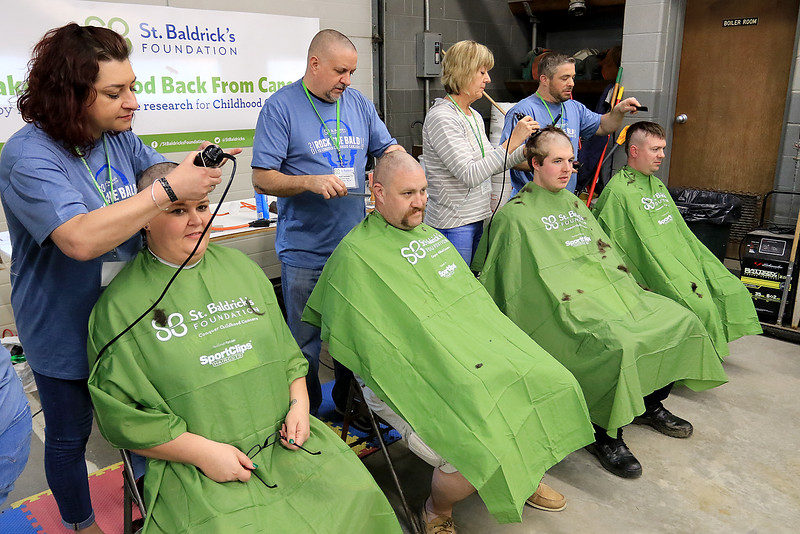 The annual St. Baldrick's event has held at the Pepperell Fire Department on Park Street on Wednesday night in Pepperell. Participants donate money to get people to cut their hair short to raise money for childhood cancer research. Many came out to participate in the event. SENTINEL & ENTERPRISE/JOHN LOVE