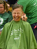 HOLLY PELCZYNSKI - BENNINGTON BANNER Nancy Diaferio, of Manchester smiles while having her head shaved to raise money for The St. Baldrick's Foundation on Wednesday morning at Manchester Elementary school.