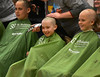 HOLLY PELCZYNSKI - BENNINGTON BANNER 4th grader Joshua Weissleder smiles while getting his head shaved with his classmates on Wednesday morning during The St. Baldrick's foundation on Wednesday morning at Manchester Elementary school.