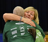HOLLY PELCZYNSKI - BENNINGTON BANNER  Hair Stylist Ronda Ihasz embraces in a hug after shaving the head of a fundraiser participant on Wednesday morning during The St. Baldrick's foundation on Wednesday morning at Manchester Elementary school.
