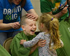 HOLLY PELCZYNSKI - BENNINGTON BANNER 5th grader Emory Martin hugs his three year old sister Liv Martin while getting his head shaved to support The St. Baldrick's foundation on Wednesday morning at Manchester Elementary school.