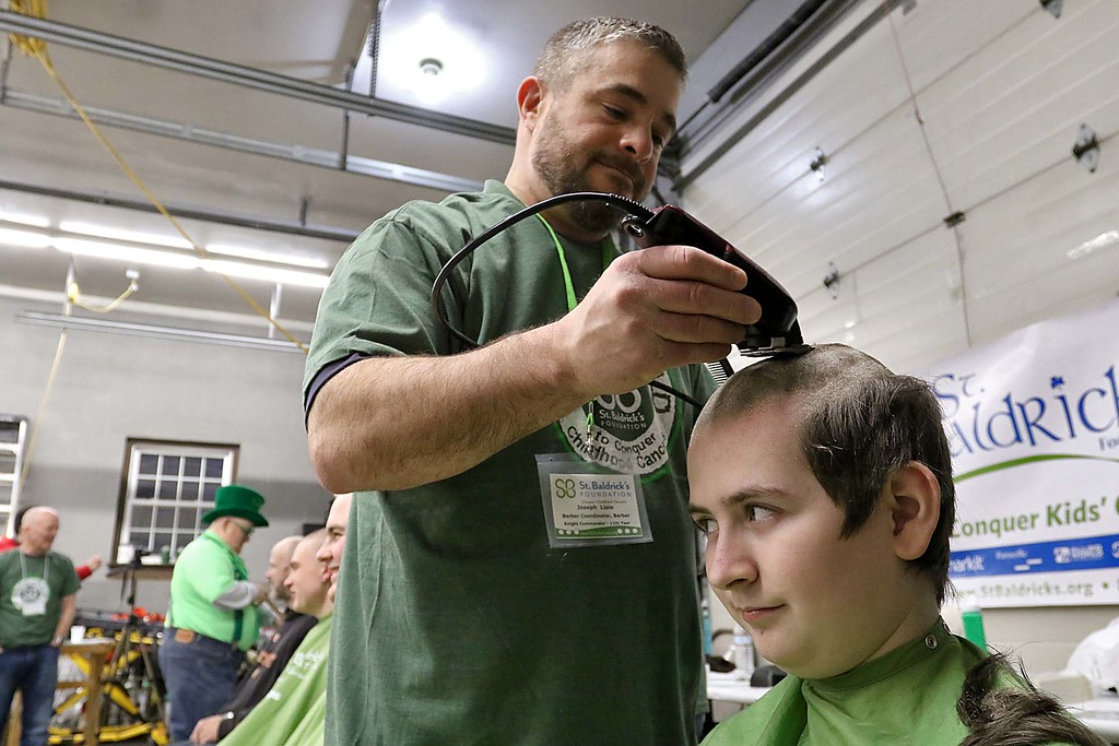 . The 16th annual St. Baldrick\'s fundraiser was held by the Pepperell Fire Department on Wednesday night, March 14, 2018. Mikey Reardon of Pepperell got his hair cut off for the cause by Joe Lisio of patriots Barbershop in Pepperell. SENTINEL & ENTERPRISE/JOHN LOVE