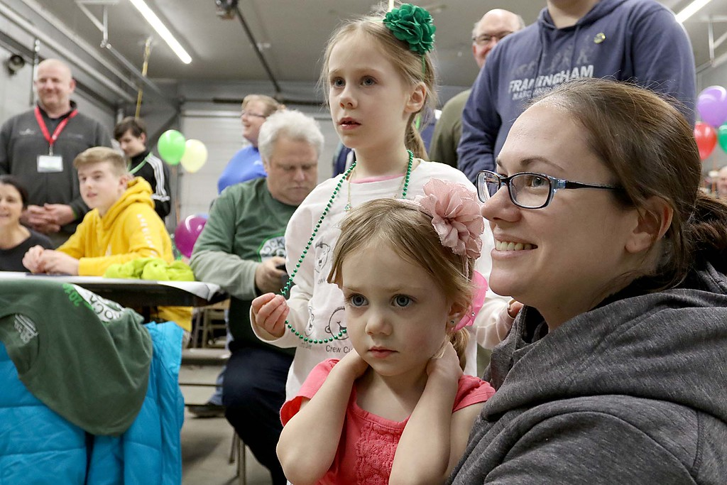 . The 16th annual St. Baldrick\'s fundraiser was held by the Pepperell Fire Department on Wednesday night, March 14, 2018. Tammy Abbot sits with her girls Lillian Abbott, 6, and Evelyn Abbott, 3, as they watch their father Josh Abbott, a Chelmsford firefighter, get his hair cut off for the cause. SENTINEL & ENTERPRISE/JOHN LOVE