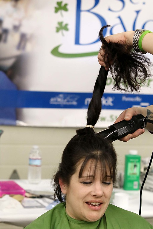. The 16th annual St. Baldrick\'s fundraiser was held by the Pepperell Fire Department on Wednesday night, March 14, 2018. Participant Nicole Sweeney, who works for the Pepperell Fire Department, gets her hair cut at the event. SENTINEL & ENTERPRISE/JOHN LOVE