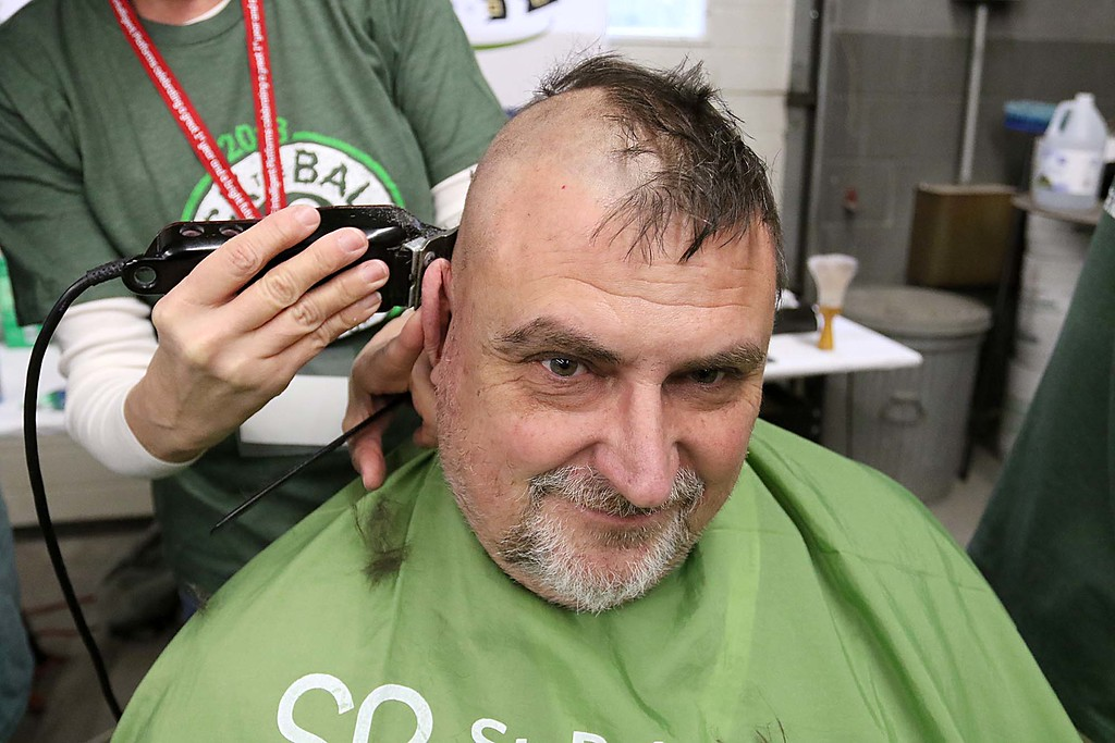 . The 16th annual St. Baldrick\'s fundraiser was held by the Pepperell Fire Department on Wednesday night, March 14, 2018. John Wing of Worcester got his hair cut for the cause. SENTINEL & ENTERPRISE/JOHN LOVE