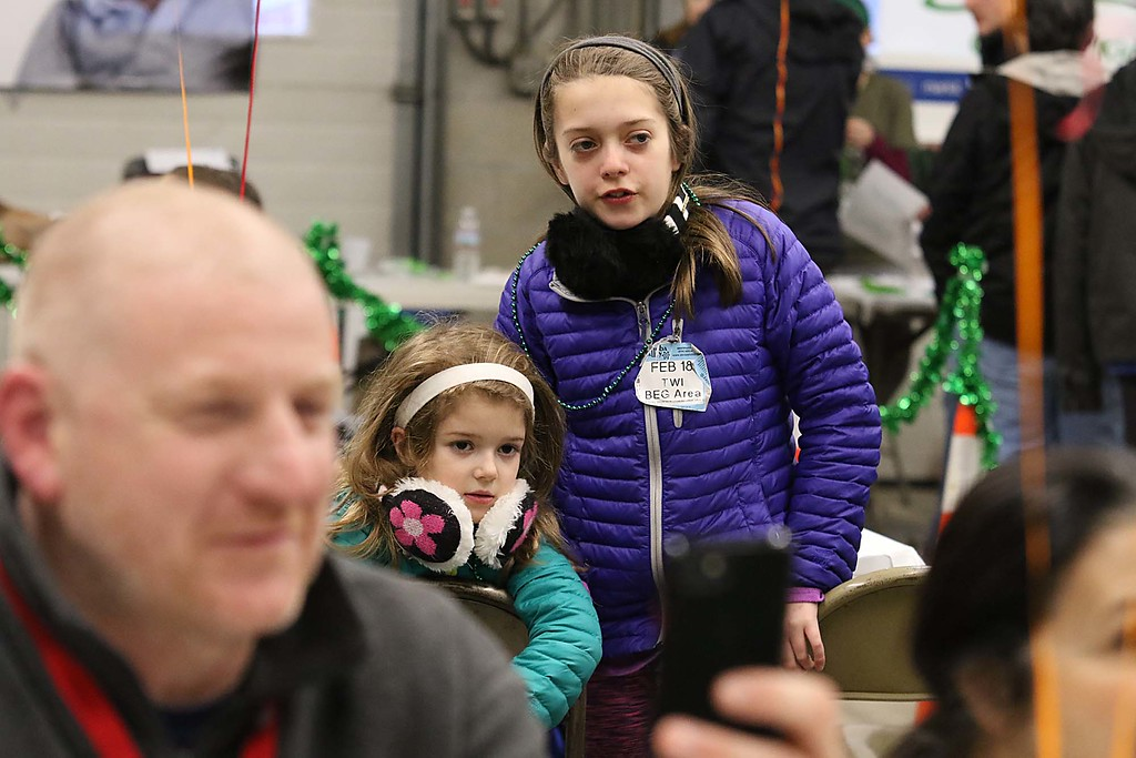 . The 16th annual St. Baldrick\'s fundraiser was held by the Pepperell Fire Department on Wednesday night, March 14, 2018. Colette Swygart, 5, and Ava Swagart, 9, of Westford watch as their dad,B.J. Swygart, got his hair cut for the cause. SENTINEL & ENTERPRISE/JOHN LOVE