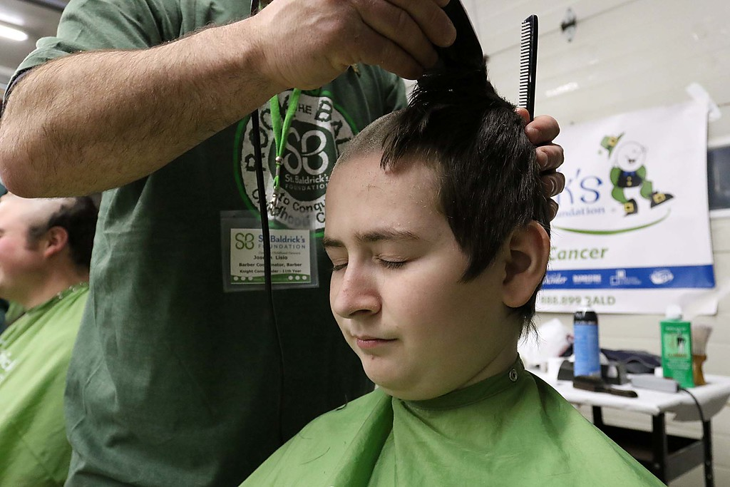 . The 16th annual St. Baldrick\'s fundraiser was held by the Pepperell Fire Department on Wednesday night, March 14, 2018. Mikey Reardon of Pepperell got his hair cut off for the cause. SENTINEL & ENTERPRISE/JOHN LOVE