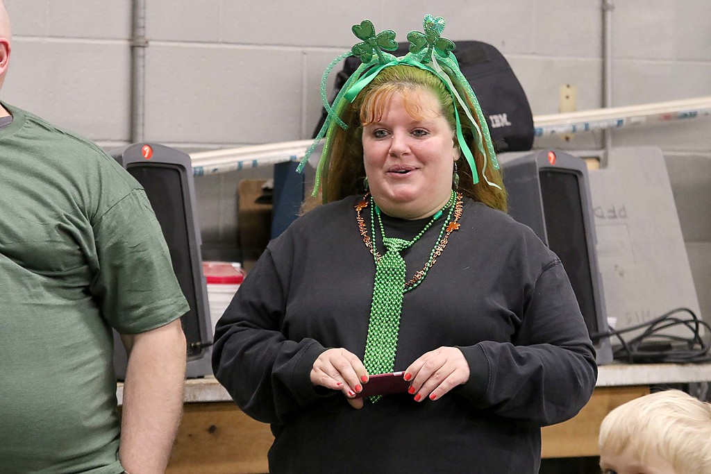 . The 16th annual St. Baldrick\'s fundraiser was held by the Pepperell Fire Department on Wednesday night, March 14, 2018. Festively dressed Jeanmarie Williams of Littleton watches as many of her co-workers from Concord Lumber Corporation got their hair cut for the cause. SENTINEL & ENTERPRISE/JOHN LOVE